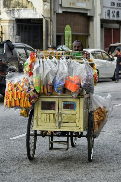 Street Seller Tricycle Snacks On Wheels Street Photography Streetphotography Pedalling Merchandise On The Road Looking Selling Food Penang Malaysia Rickshaw Tidbits Mobile Working Hard Earning A Living Salesman Sales On The Street Packets Car Feel The Journey Food On The Go Food On Wheels The Street Photographer - 2016 EyeEm Awards
