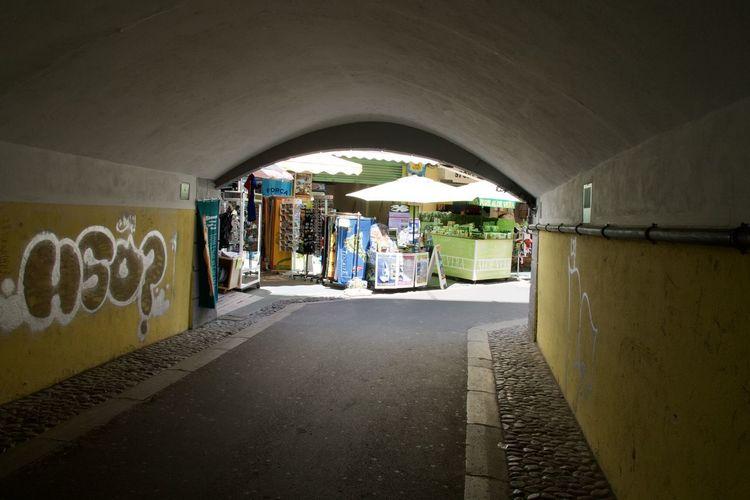 People walking on street in tunnel