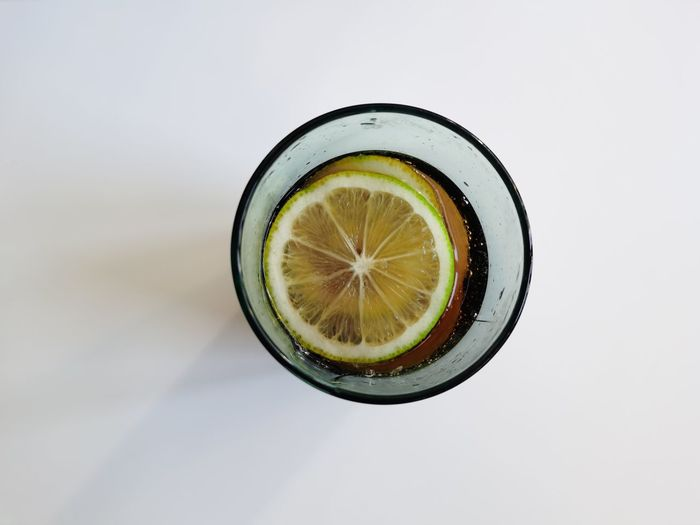 Directly above shot of drink in glass against white background