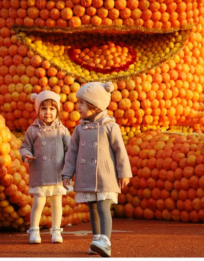 citrus and children Childhood Child Full Length Offspring Food Fruit Males  Two People Food And Drink Men Healthy Eating Togetherness Females Wellbeing Smiling People Happiness Women Casual Clothing Brother
