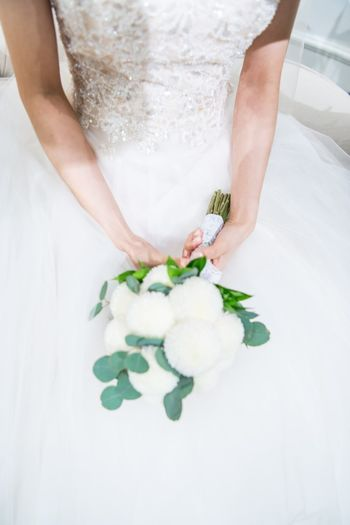 Adult Bouquet Bride Celebration Celebration Event Ceremony Close-up Day Flower Freshness Groom Holding Human Hand Indoors  Life Events Midsection One Person People Real People Wedding Wedding Ceremony Wedding Dress Well-dressed White Color Women