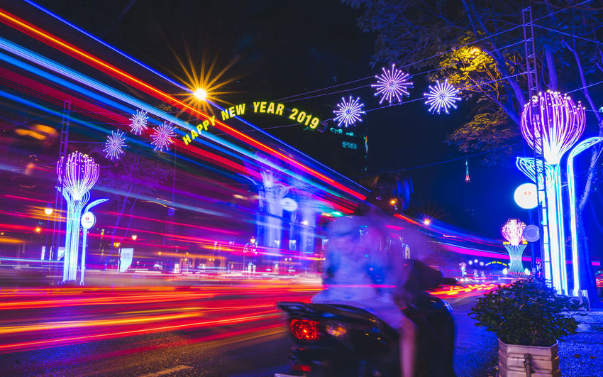 Happy New Year in Asia. Luna new year celebration. Ho Chi Minh City, Vietnam 2019 Illuminated Night Motion Blurred Motion Long Exposure City Architecture Street Speed Light Trail Glowing Multi Colored Built Structure No People Lighting Equipment Road Transportation City Street Decoration Light Happy New Year Luna New Year Tết Tetholiday New Year 2019