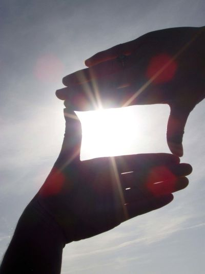 Close-up of hand holding sun
