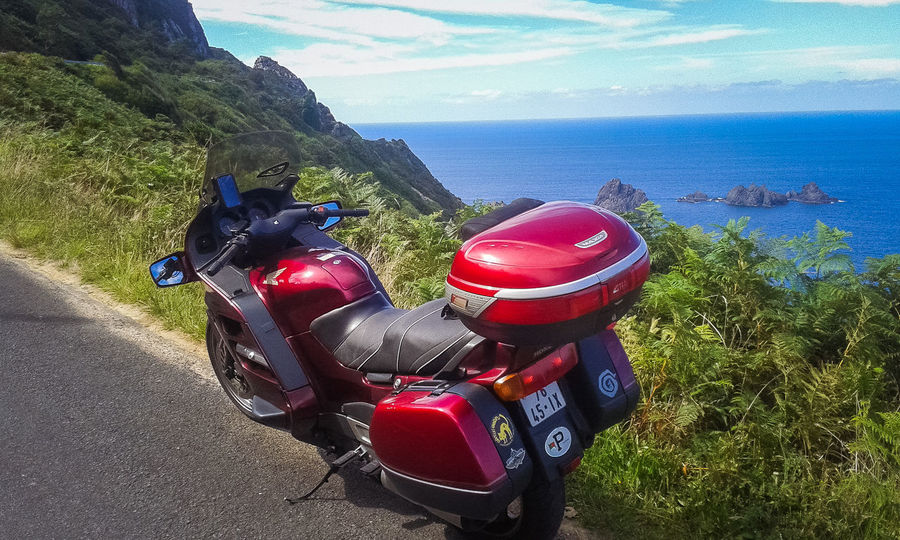 Beauty In Nature Day Horizon Over Water Mode Of Transport Motorcycle Nature No People Outdoors Red Road Scenics Sea Sky Transportation