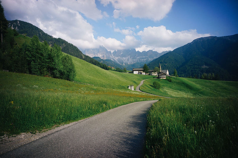 Dolomite Italy Road Grass Scenics - Nature Mountain Plant Environment Cloud - Sky Sky Landscape Tranquil Scene Beauty In Nature Tranquility Nature Land Transportation Mountain Range No People Green Color Rural Scene Field Outdoors Italy Landscape_Collection Landscape_photography