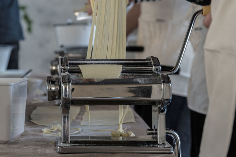 Close Up Of Person Making Pasta