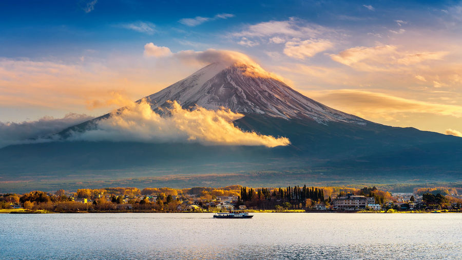 Fuji mountain and Kawaguchiko lake at sunset, Autumn seasons Fuji mountain at yamanachi in Japan. Architecture Beauty In Nature Cloud - Sky Day Mountain Mountain Range Nature Nautical Vessel No People Outdoors Scenics Sky Sunset Tranquility Transportation Travel Destinations Water Waterfront