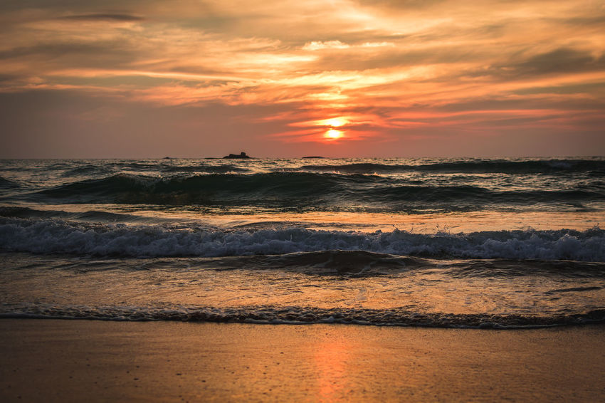 the peace and sense of belonging that you get on a beach as you see the setting sun is comparable to none. you feel as if all your sorrows and pain is going away with the receding waves while the red and orange skies give you comfort and tranquility Bentota Beach Sri Lanka Beach Beauty In Nature Cloud - Sky Day Horizon Over Water Idyllic Motion Nature No People Orange Color Outdoors Reflection Scenics Sea Sky Sun Sunset Tranquil Scene Tranquility Water Wave