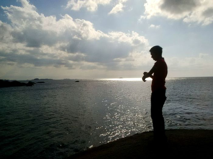 Side view of silhouette man standing at beach
