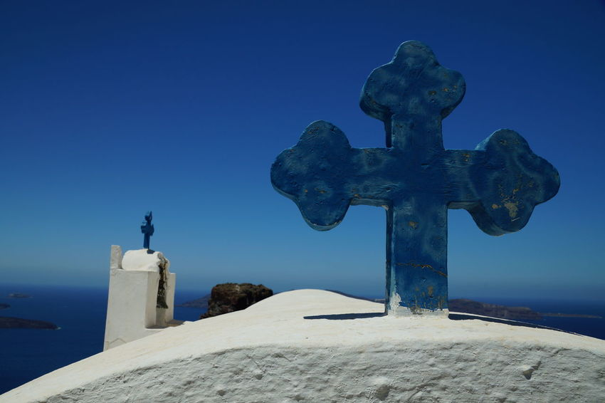 Blue Clear Sky Close-up Cross Day No People Outdoors Religion Sculpture Sky Spirituality