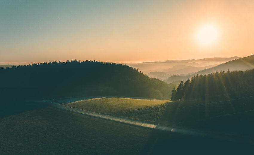 Beauty In Nature Day Grass Green Horizon Over Land Landscape Lightbeams Mountain Nature No People Orange Outdoors Road Rural Scene Sauerland Scenics Sky Sun Sunlight Sunset Tranquil Scene Tranquility Tree View From Above Willingen Flying High