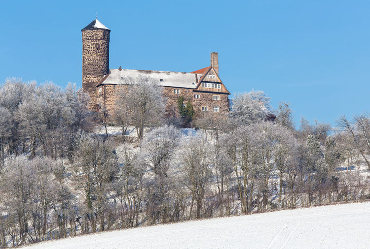 Burg Ludwigstein 51°19'6 N 9°54'45 E Burg Ludwigstein Architecture Bare Tree Building Exterior Built Structure Clear Sky Cold Temperature Day History Nature No People Outdoors Snow Winter