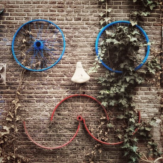 Amsterdam Architecture Brick Wall Building Exterior Bycicle Close-up Day Face No People Outdoors Streetart Thingswithfaces Tire Wall - Building Feature