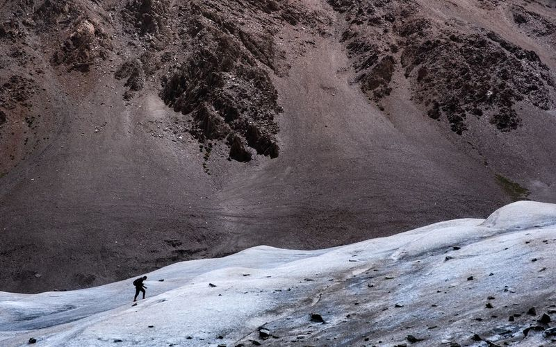 High angle view of person on snowcapped mountain
