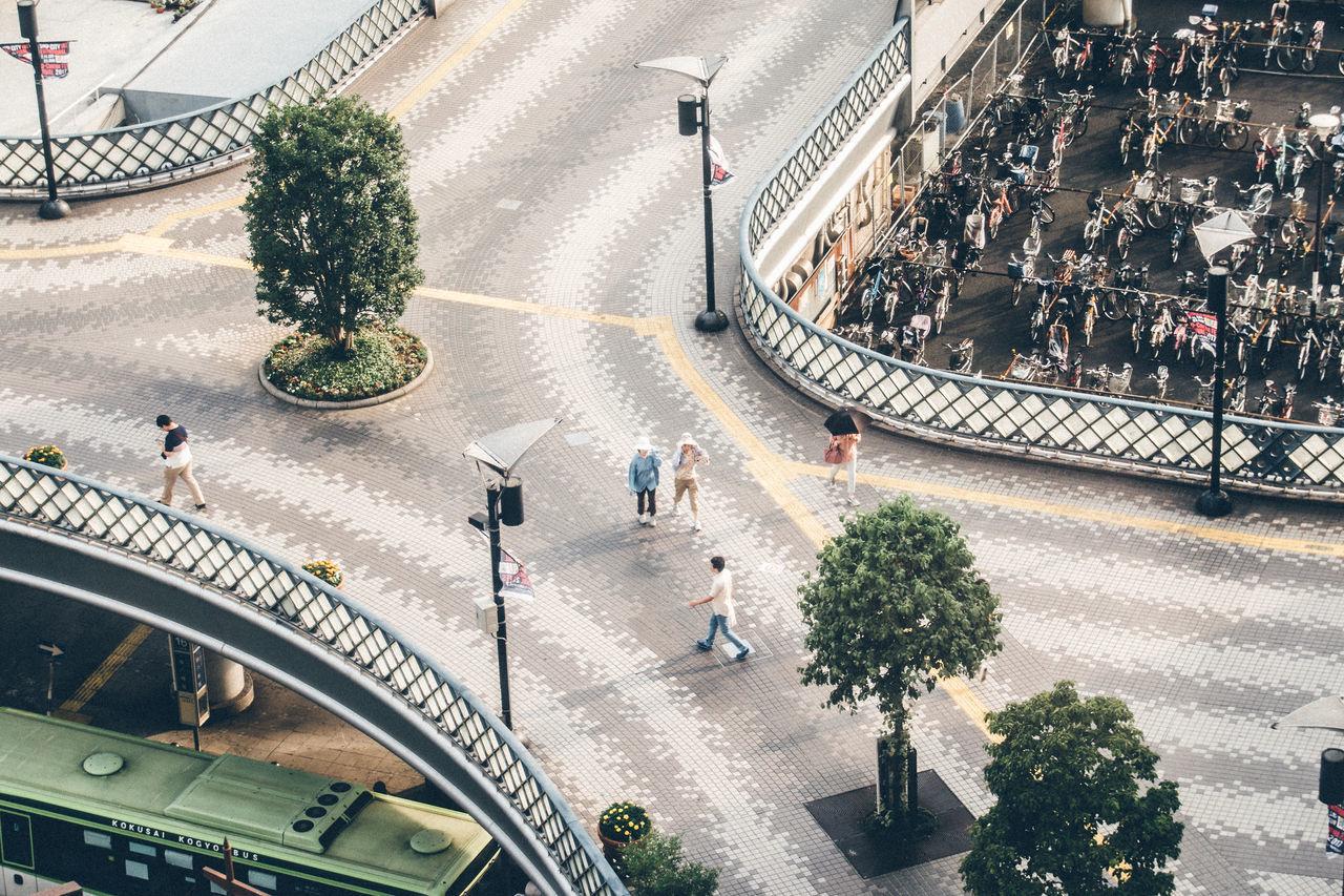 High angle view of people walking at bridge
