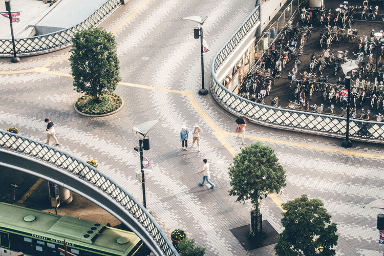 High angle view of people walking at bridge
