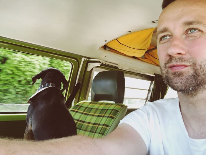 Road trip with doggie Puppy Dog Headshot Portrait Real People Young Adult Lifestyles Young Men One Person Adult Leisure Activity Beard Men Mature Men