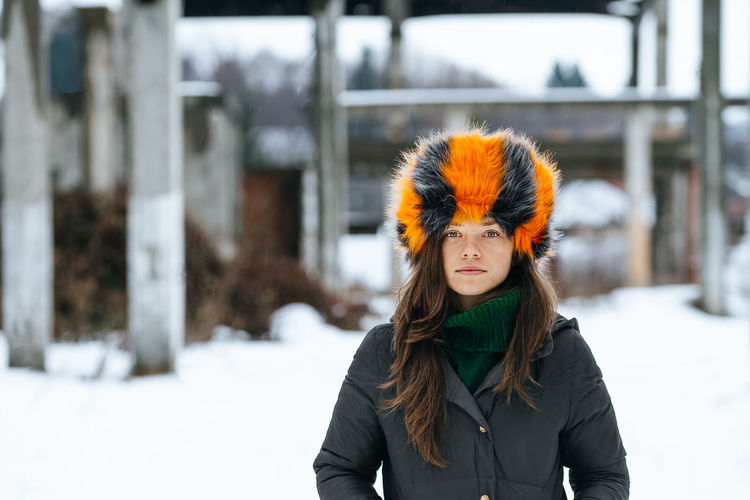 Portrait Of Woman Wearing Fur Hat While Standing On Snow
