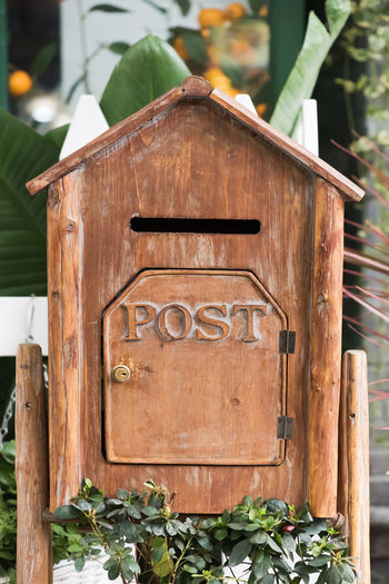 box of post Box Brown Close-up Communication Day Focus On Foreground Information Information Sign Leaf Nature No People Number Outdoors Plant Plant Part Script Sign Text Western Script Wood - Material