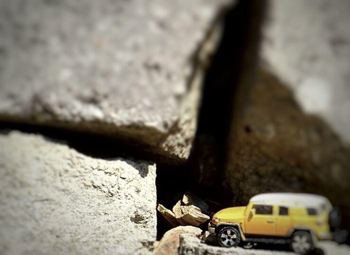 Houston we have a problem Car Miniature Toy Photography Stucked Car Awd Car Rocks Car Stucked On The Rocks