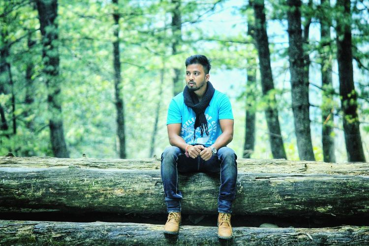 Full Length Tree Men Sitting Portrait Forest Front View Casual Clothing