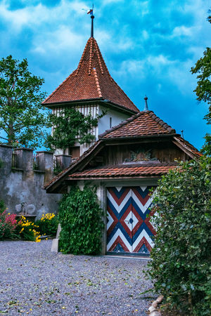 Architecture Brick Wall Building Exterior Built Structure Day Geometry High Angle View House No People Old Ornate Outdoors Religion Residential Structure Roof Roof Tile Rooftop Spirituality Symmetry Town