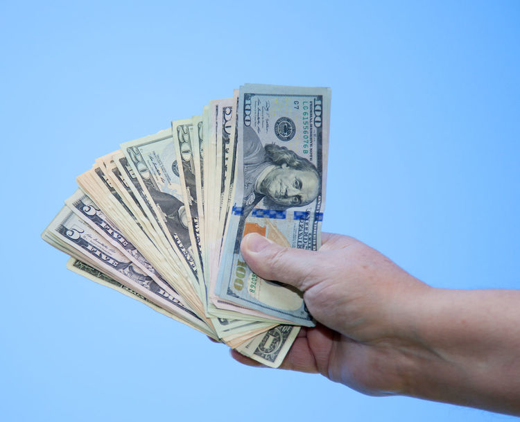 Hand holding dollar notes Blue Sky Cash Cash Money Currency Dollar Notes Financial Planning Hand Income Money Money Money Money Payment Payment In Cash US Dollar