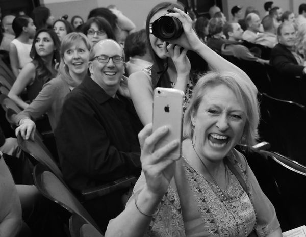 Reacting as their college graduate enters the auditorium during her commencement ceremony. Check This Out Graduation Commencement Happiness Joy Joyful Moments Family Celebrate Celebration Smile Photography The Photojournalist - 2016 EyeEm Awards