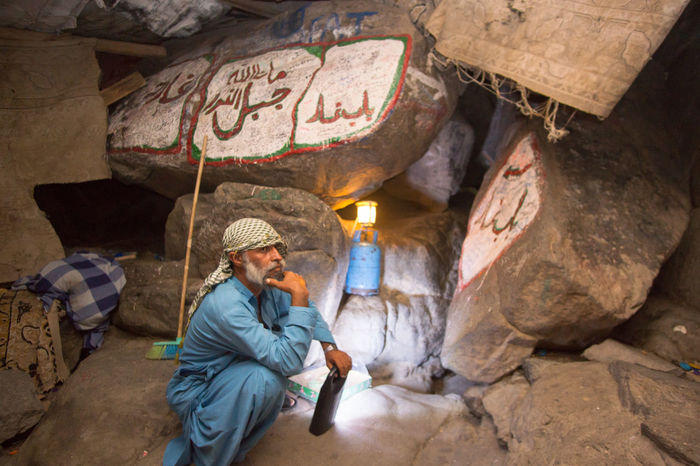An Unidentified Arab Who Taking Care Of The Entrance Of Cave Of Hira Which About 3 Kilometres From Mecca, On The Mountain Named Jabal Nur In The Hejaz Region Adult Architecture Beautiful Crowd Eid Eid Mubarak Hajj Islam Kaaba Man Mecca Medina Muslim One Person Outdoors People Pilgrimage Ramadan  Ramadhan Religion Saudi Arabia Sitting Syawal Umrah Woman The Portraitist - 2017 EyeEm Awards