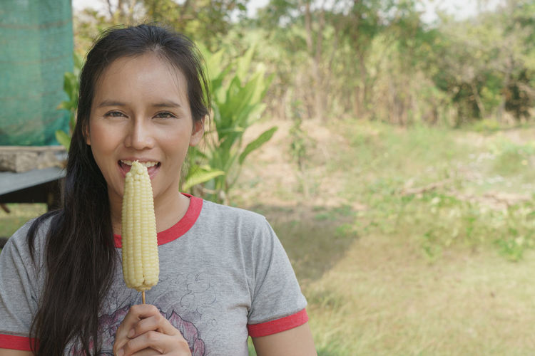 Portrait of smiling girl holding ice cream