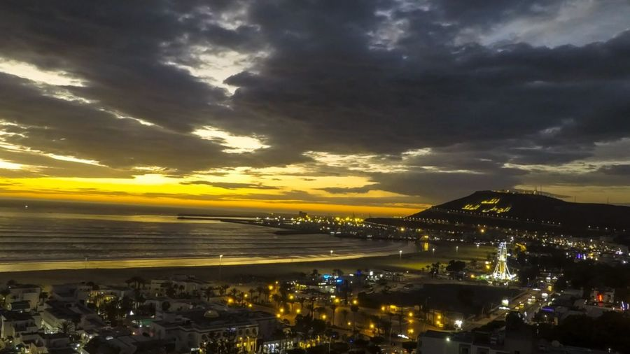 Sunset in Agadir Morocco instagram : medtmart Photo Photography Light And Shadow Sky And Clouds Ocean Coucherdesoleil Soleil Sky Cloud - Sky Outdoors Sunset Nature Built Structure Cityscape Scenics Building Exterior No People Illuminated City Architecture Horizon Over Water Beauty In Nature Yellow Storm Cloud Water Day