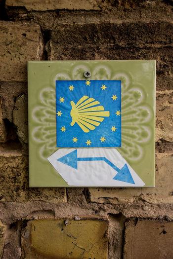 Blue Built Structure Close-up Communication Design Human Representation Information Jakobsweg Pilgern Pilgrimage Representation Schild Sign The Way Of St James Wall - Building Feature Yellow