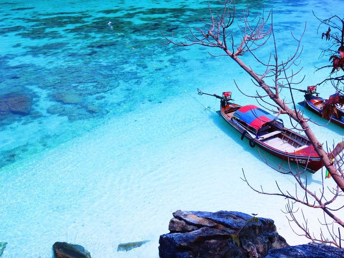 Water Sea Beach Photography Beauty In Nature Beach Sand Water Nautical Vessel Transportation Nature Day Sea Beauty In Nature Beach High Angle View Mode Of Transportation Blue Tranquility Scenics - Nature Real People Land Tranquil Scene Outdoors Rock Lifestyles