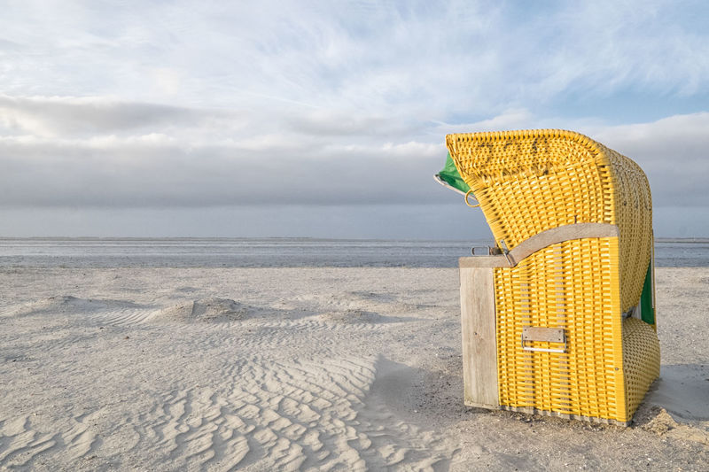 Beach Beach Chair Beach Holiday Calm Leaving Lonely Sand Beach Sandy Beach Sky Sky And Clouds Yellow North Sea
