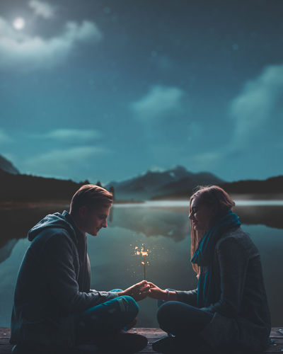 couple in love under the moonlight Holding Hands Love HUAWEI Photo Award: After Dark Friendship Water Young Women Warm Clothing Togetherness Men Happiness Smiling Bonding Winter Couple Groom Lakeside Dramatic Sky Falling In Love Calm Countryside Shore Hugging EyeEmNewHere