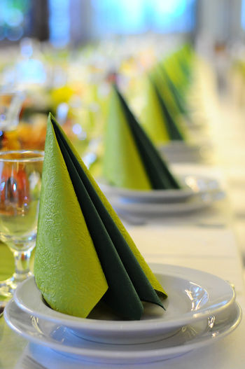 Close-up of place setting on dining table during wedding