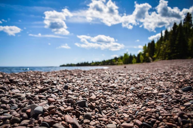 Lake Superior shoreline EyeEm Best Shots Sky Cloud - Sky Land Nature Pebble Tranquil Scene Solid Stone - Object Scenics - Nature Beauty In Nature Rock Beach No People Day Tranquility Outdoors Water Stone Sea Tree