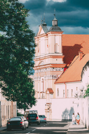 Grodno, Belarus. People Walking Near Catholic Church Of The Annunciation Of The Blessed Virgin Mary And A Bridgettine Monastery At Sunny Summer Day In Hrodna, Belarus Annunciation Blessed Virgin Mary Bridgettine Monastery Bridgettine Order Bridgettines Brigittine Grodno Hrodna Belarus Building Cathedral Catholic Christ Christian Church City Culture Famous Historic Holy Landmark Monastery Religion Saint Summer Sunny Tourism Town Traditional Travel Worship