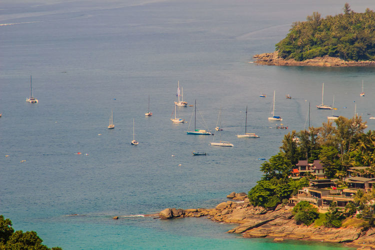 Tropical beach seascape panorama view with boats and yatchs. Beautiful turquoise ocean waives with boats and sandy coastline from high view point. Kata and Karon beaches, Phuket, Thailand Aerial Seascape Coastline Coastline Landscape Coastline Nature Water Karon Beach, Phuket Karon Beach, Phuket, Thailand Kata Beach Kata Beach,Phuket Thailand Phuket,Thailand Seascape Photography Aerial Landscape Aerial View Beauty In Nature Boats Coastline Beauty Coastline Sky Day Harbor High Angle View Karon Karon Beach Karon View Point Kata Noi Beach Mast Moored Mountain Nature Nautical Vessel No People Outdoors Sailboat Sailing Scenics Sea Seascape Seascape Skyscape Sky Tranquility Transportation Tree Turquoise Sea Water Waterfront Yacht Yatch Marine Yatching