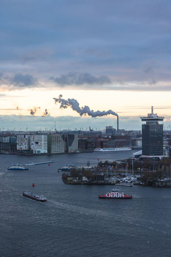 Nautical Vessel Sky Cloud - Sky Water Building Exterior Built Structure Architecture Transportation Waterfront Mode Of Transportation Sunset Nature Sea Industry No People City Outdoors Shipping  Freight Transportation Passenger Craft