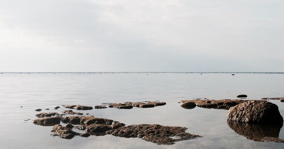 calm water EyeEm Nature Lover Seascape Water Rocks Horizon Over Water Horizon EyeEm Gallery EyeEm EyeEm Best Shots - Nature Clear Sky Clear Water Serenity Place Vacations Outdoors Traveling