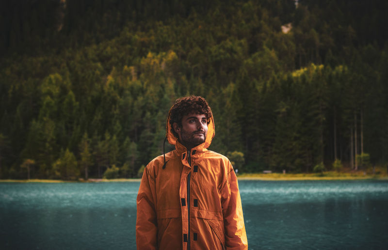 Portrait of young man looking at lake