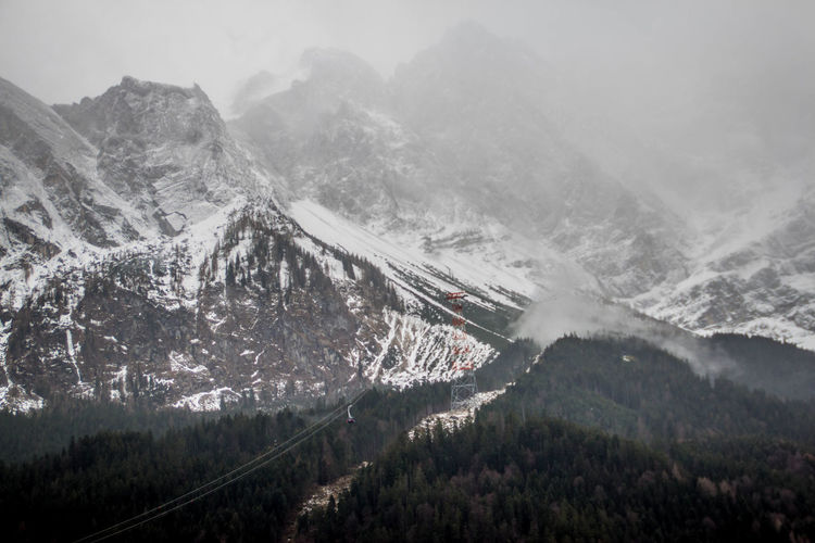 Mountain Scenics - Nature Beauty In Nature Fog Cold Temperature Nature Winter Tranquil Scene No People Mountain Range Transportation Day Non-urban Scene Environment Tranquility Plant Water Snow Tree Outdoors Snowcapped Mountain Mountain Peak