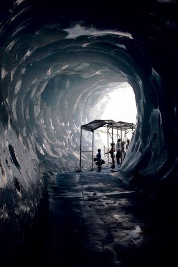 Silhouette people on frozen sea against sky