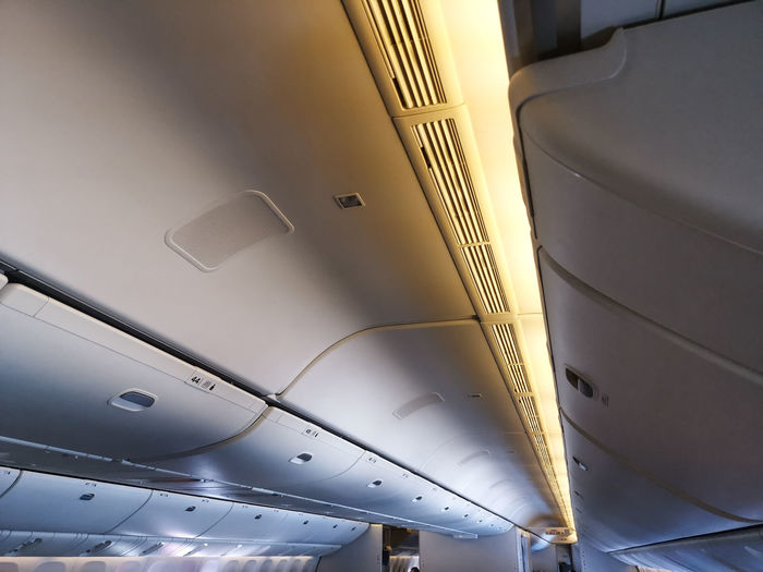 Low angle view of illuminated ceiling in airplane
