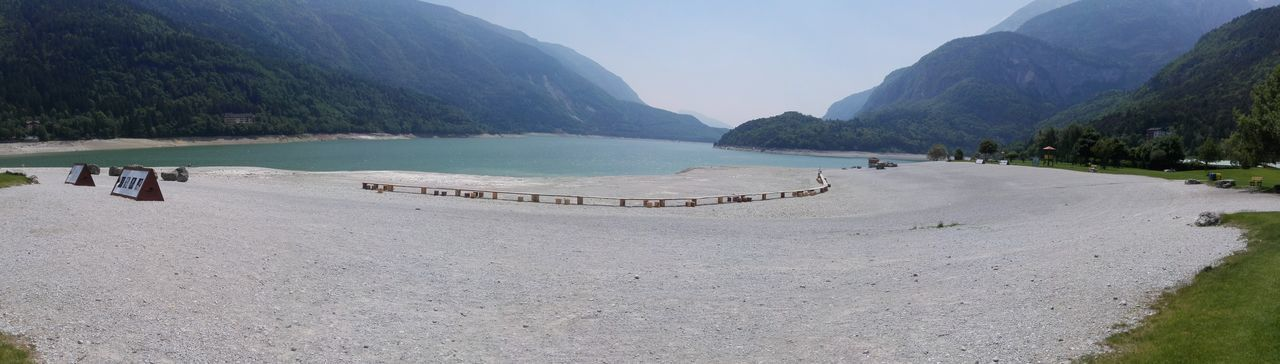 Lake Molveno Panoramic Photography Panoramic View First Eyeem Photo EyeEmNewHere EyeEm Nature Lover Eye4photography  Nature Lake View Lakes  Panorama Panoramic Beach Beachphotography Beach Photography EyeEm Best Shots - Nature Tree Water Mountain Beach Sand Swimming Landscape Sky Coast Calm Rocky Mountains