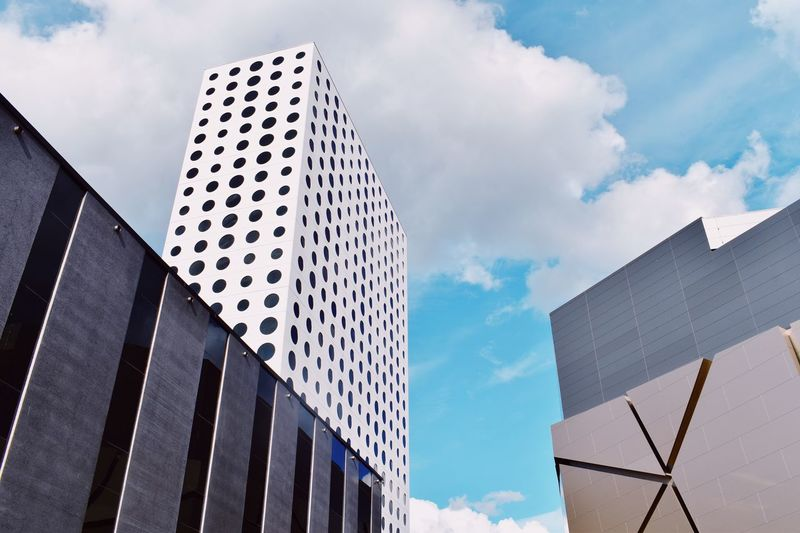 EyeEm Selects Cloud - Sky Building Exterior Sky Architecture Built Structure Low Angle View Building No People Day City Outdoors Pattern Blue Sunlight Tall - High Modern