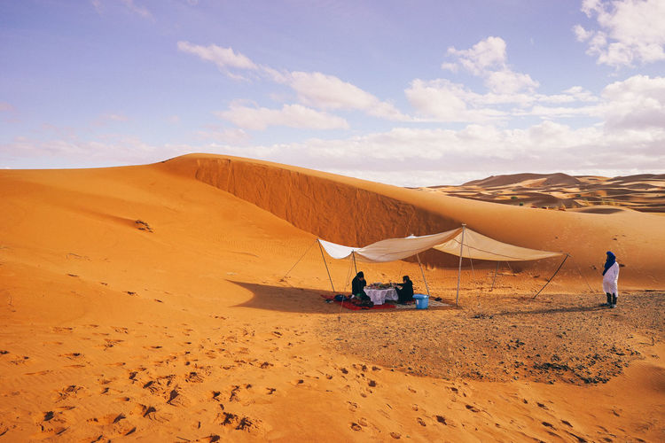 Lunch time in the middle of Sahara Desert Sand Land Sky Scenics - Nature Beauty In Nature Desert Cloud - Sky Climate Arid Climate Tranquility Nature Real People Tranquil Scene Sand Dune Environment Non-urban Scene Landscape Day Men Lifestyles Outdoors Lunchtime