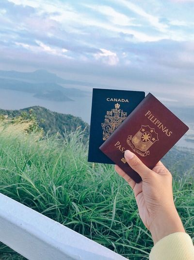 This photo was taken at Tagaytay overlooking the Taal Volcano. Human Hand Human Body Part Holding One Person Personal Perspective Cloud - Sky Sky Real People Day Outdoors Close-up Grass Beauty In Nature Nature People Eyeem Philippines Connected By Travel