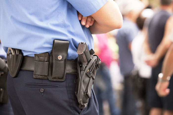 A policeman on duty Armed Police Crime Gun On Duty On Alert Police Officer Policeman Protest Armed Focus On Foreground Law Law Enforcement Law Enforcement Officer Officer Police Force Protecting Protection Public Order Readiness Real People Safety Security Uniform Vigilance  Weapon